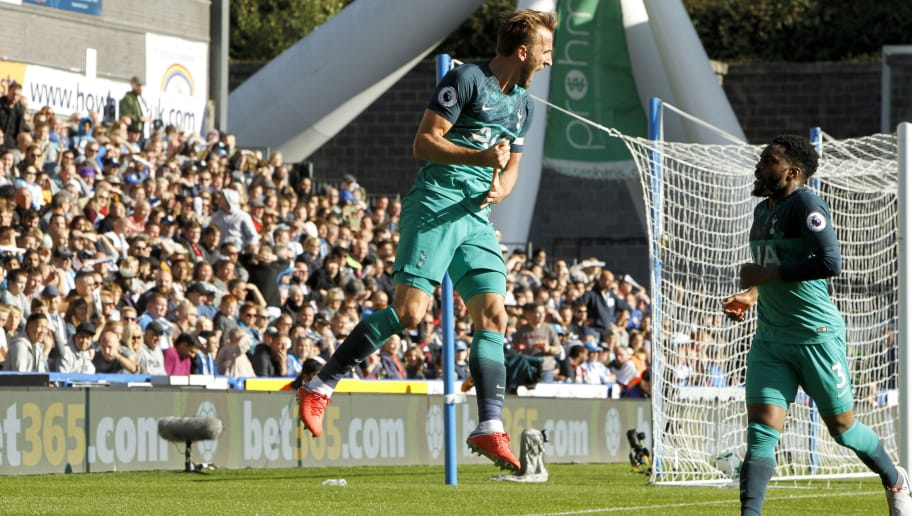 HUDDERSFIELD, ENGLAND - SEPTEMBER 29:  Harry Kane of Tottenham Hotspur celebrates scoring the opening goal during the Premier League match between Huddersfield Town and Tottenham Hotspur at John Smith's Stadium on September 29, 2018 in Huddersfield, United Kingdom. (Photo by Ben Early/Getty Images)