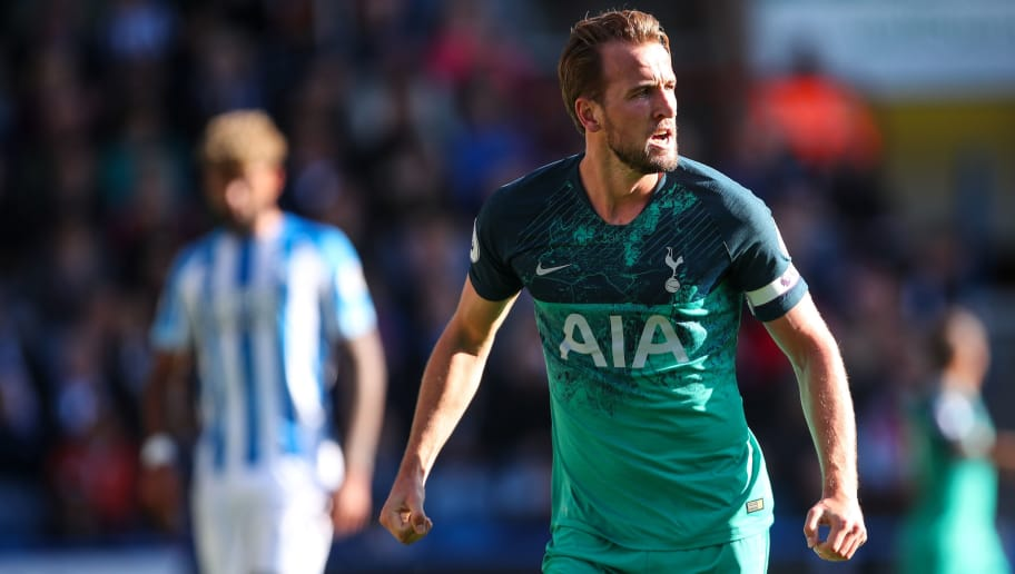 HUDDERSFIELD, ENGLAND - SEPTEMBER 29:  Harry Kane of Tottenham Hotspur celebrates after scoring a goal to make it 0-1 during the Premier League match between Huddersfield Town and Tottenham Hotspur at John Smith's Stadium on September 29, 2018 in Huddersfield, United Kingdom. (Photo by Robbie Jay Barratt - AMA/Getty Images)