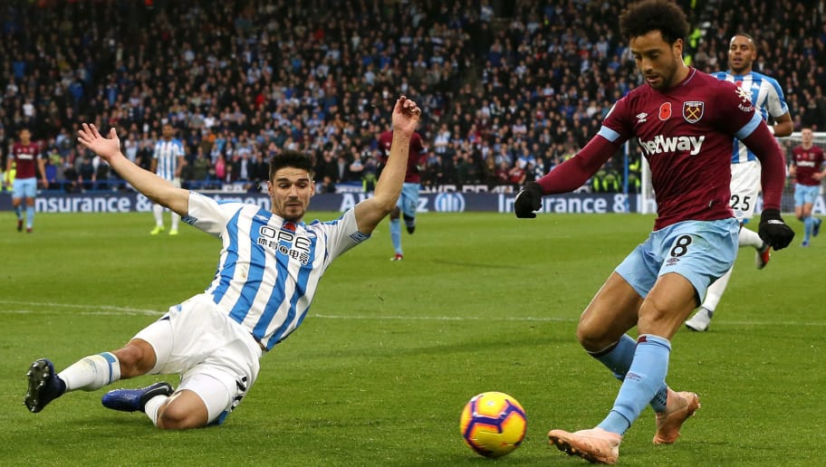 HUDDERSFIELD, ENGLAND - NOVEMBER 10:  Christopher Schindler of Huddersfield Town attempts to block a cross from Felipe Anderson of West Ham United during the Premier League match between Huddersfield Town and West Ham United at the John Smith's Stadium on November 10, 2018 in Huddersfield, United Kingdom.  (Photo by Nigel Roddis/Getty Images)