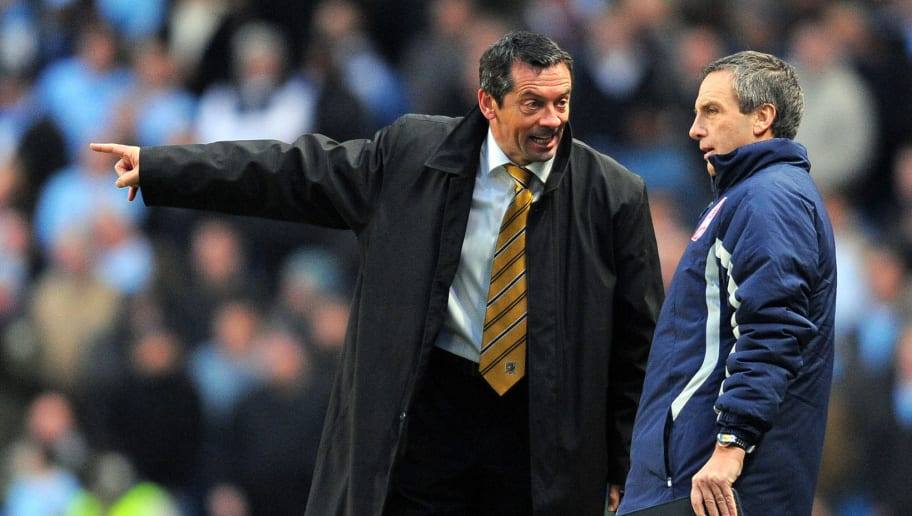Hull City manager Phil Brown (L) talks t