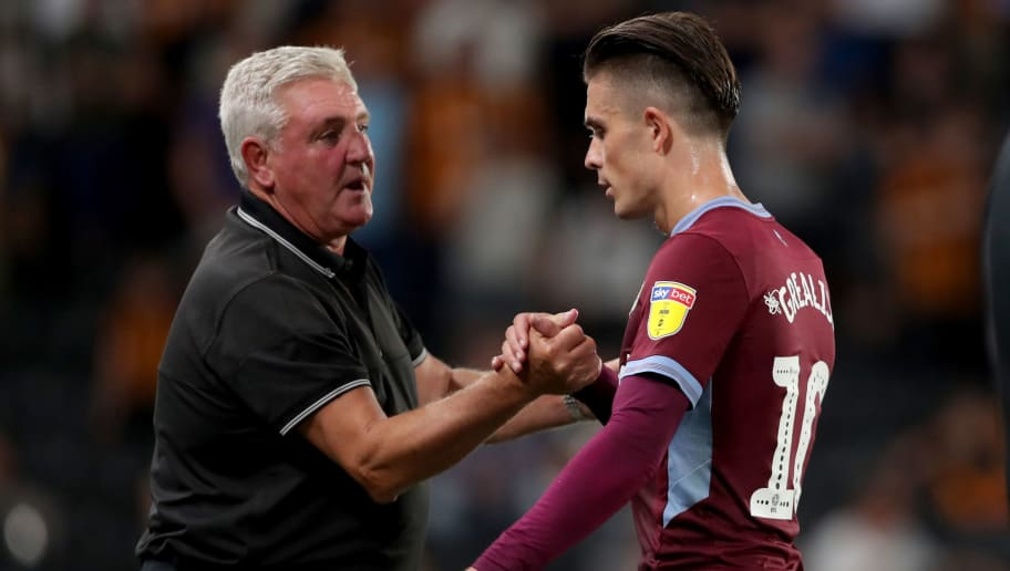 HULL, ENGLAND- AUGUST 06: Steve Bruce the Aston Villa manager with Aston Villa's Jack Grealish during the Sky Bet Championship  match between Hull City and Aston Villa at the KCOM Stadium on August 6, 2018 in Hull, England. (Photo by Richard Sellers/Getty Images)