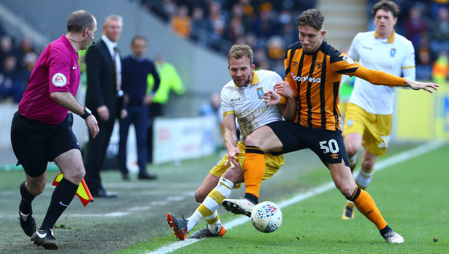 HULL, ENGLAND - APRIL 14: Angus MacDonald of Hull City wins the ball from Jordan Rhodes of Sheffield Wednesday during the Sky Bet Championship match between Hull City and Sheffield Wednesday at KCOM Stadium on April 14, 2018 in Hull, England. (Photo by Ashley Allen/Getty Images)