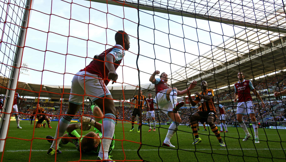 HULL, ENGLAND - SEPTEMBER 28:  Kevin Nolan of West Ham clears the ball off the goal line during the Barclays Premier League match between Hull City and West Ham United at KC Stadium on September 28, 2013 in Hull, England.  (Photo by Matthew Lewis/Getty Images)