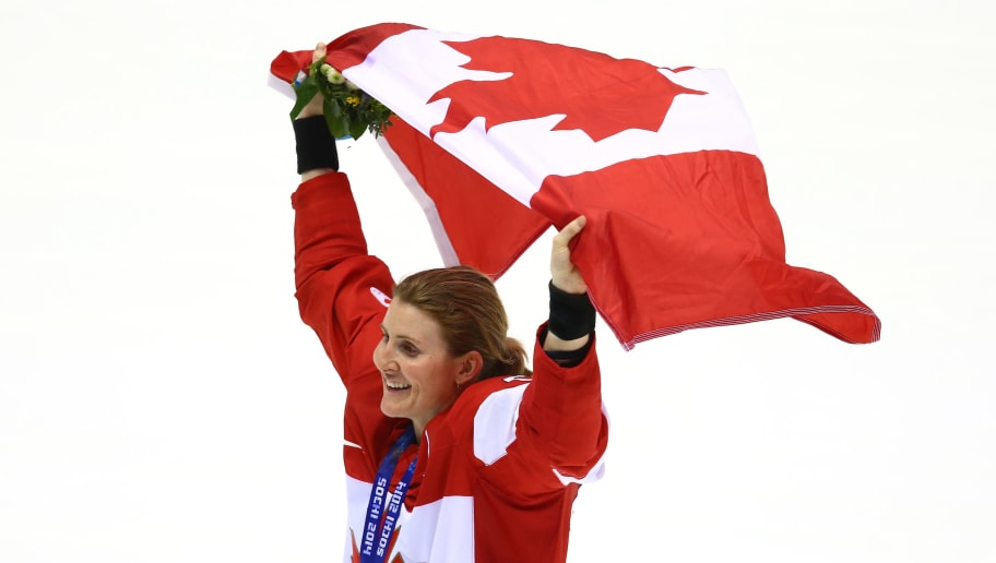 SOCHI, RUSSIA - FEBRUARY 20: Gold medalist Hayley Wickenheiser #22 of Canada celebrates after defeating the United States 3-2 in overtime during the Ice Hockey Women's Gold Medal Game on day 13 of the Sochi 2014 Winter Olympics at Bolshoy Ice Dome on February 20, 2014 in Sochi, Russia.  (Photo by Doug Pensinger/Getty Images)