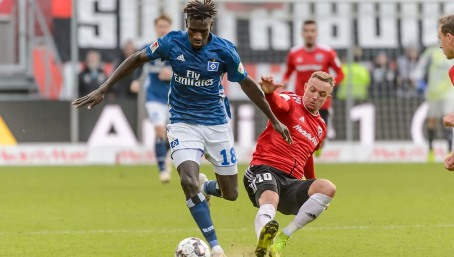INGOLSTADT, GERMANY - DECEMBER 01: Bakery Jatta of Hamburg and Sonny Kittel of Ingolstadt battle for the ball during the Second Bundesliga match between FC Ingolstadt 04 and Hamburger SV at Audi Sportpark on December 1, 2018 in Ingolstadt, Germany. (Photo by TF-Images/TF-Images via Getty Images)