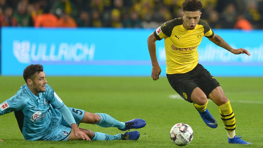 DORTMUND, GERMANY - DECEMBER 01: Manuel Gulde of Freiburg and Jadon Sancho of Dortmund battle for the ball during the Bundesliga match between Borussia Dortmund and Sport-Club Freiburg at Signal Iduna Park on December 01, 2018 in Dortmund, Germany. (Photo by TF-Images/Getty Images)