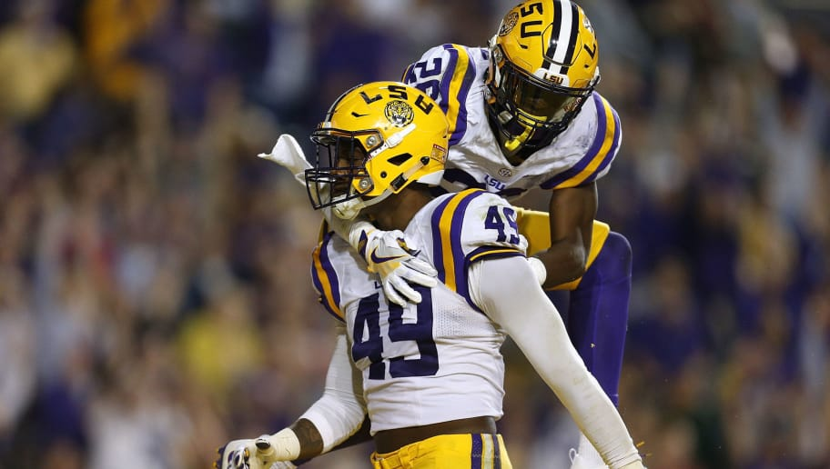 BATON ROUGE, LA - OCTOBER 22: Arden Key #49 of the LSU Tigers celebrates with John Battle #26 during the second half of a game against the Mississippi Rebels at Tiger Stadium on October 22, 2016 in Baton Rouge, Louisiana.  (Photo by Jonathan Bachman/Getty Images)