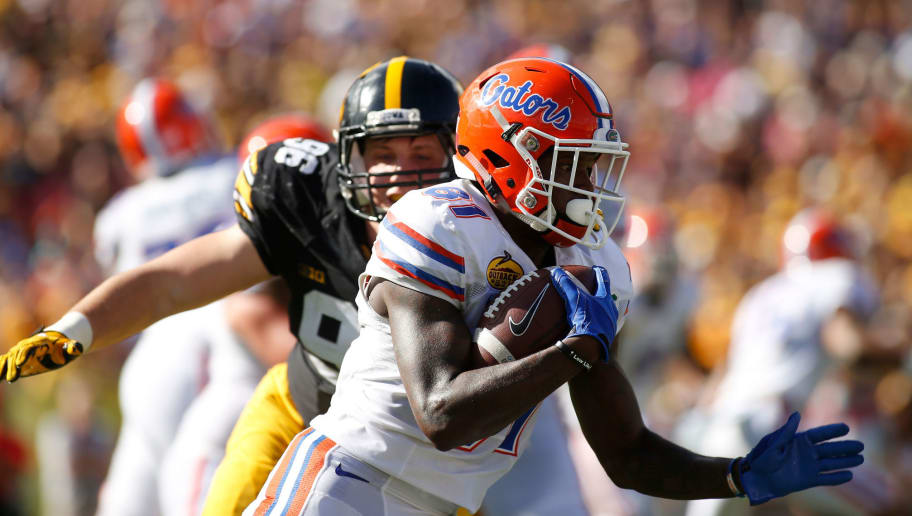 TAMPA, FL - JANUARY 2:  Wide receiver Antonio Callaway #81 of the Florida Gators evades defensive end Matt Nelson #96 of the Iowa Hawkeyes during a carry in the first quarter of the Outback Bowl NCAA college football game on January 2, 2017 at Raymond James Stadium in Tampa, Florida. (Photo by Brian Blanco/Getty Images)