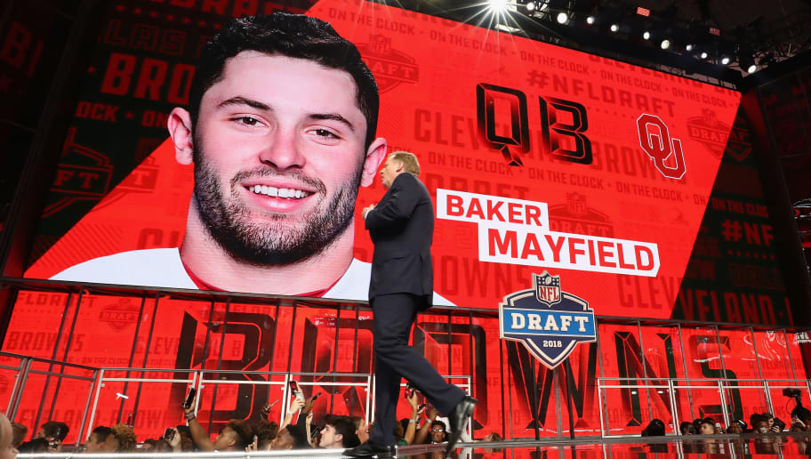 ARLINGTON, TX - APRIL 26:  NFL Commissioner Roger Goodell walks past a video board displaying an image of Baker Mayfield of Oklahoma after he was picked #1 overall by the Cleveland Browns during the first round of the 2018 NFL Draft at AT&T Stadium on April 26, 2018 in Arlington, Texas.  (Photo by Ronald Martinez/Getty Images)