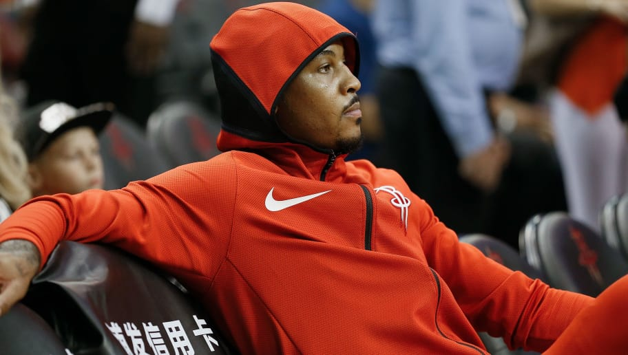 HOUSTON, TX - OCTOBER 04: Carmelo Anthony #7 of the Houston Rockets looks on from the bench during warm ups against the Indiana Pacers at Toyota Center on October 4, 2018 in Houston, Texas.  NOTE TO USER: User expressly acknowledges and agrees that, by downloading and or using this photograph, User is consenting to the terms and conditions of the Getty Images License Agreement. (Photo by Bob Levey/Getty Images)