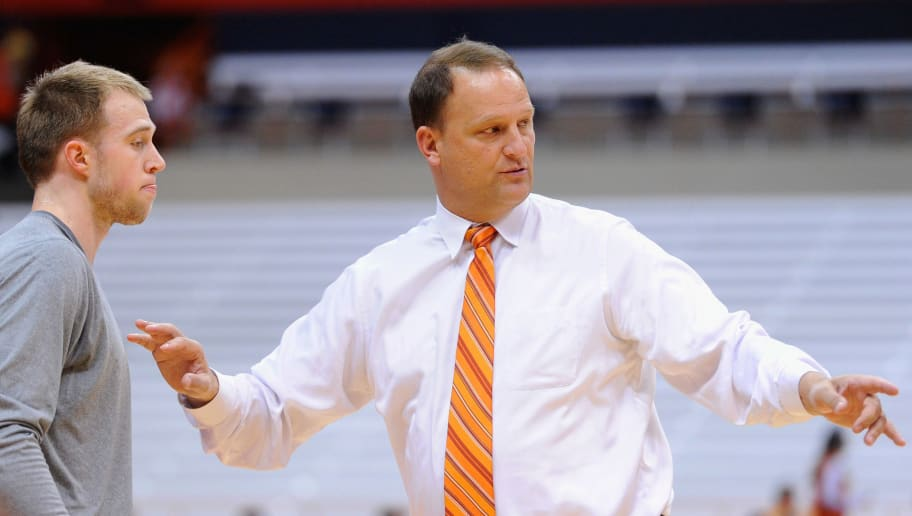 SYRACUSE, NY - DECEMBER 03:  (L-R) Trevor Cooney #10 of the Syracuse Orange and ESPN analyst Dan Dakich talk prior to the game against the Indiana Hoosiers at the Carrier Dome on December 3, 2013 in Syracuse, New York.  Syracuse defeated Indiana 69-52.  (Photo by Rich Barnes/Getty Images)