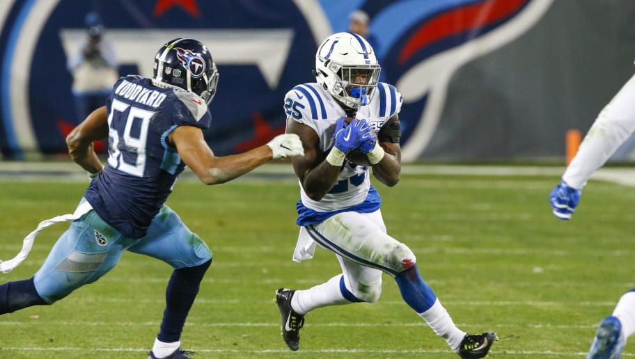NASHVILLE, TN - DECEMBER 30: Marlon Mack #25 of the Indianapolis Colts runs with the ball while defended by Wesley Woodyard #59 of the Tennessee Titans at Nissan Stadium on December 30, 2018 in Nashville, Tennessee. (Photo by Frederick Breedon/Getty Images)
