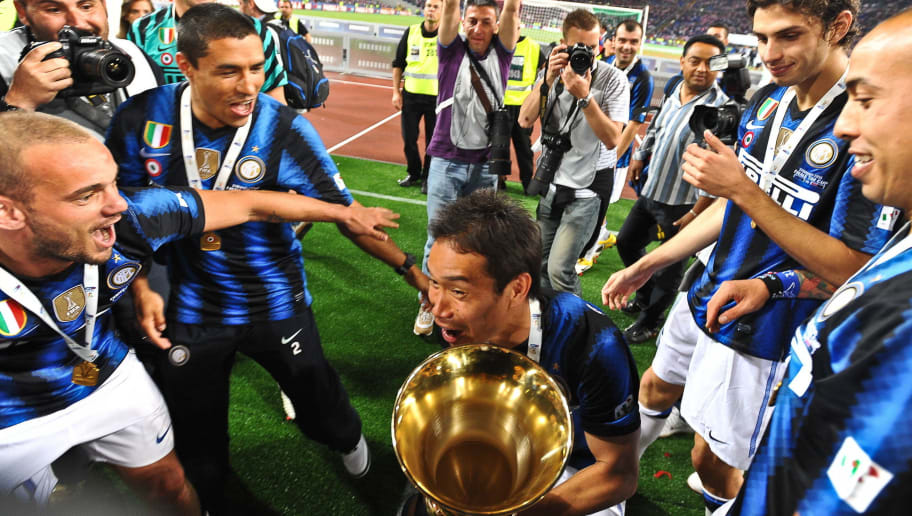 Inter Milan's Japanese midfielder Yuto Nagatomo (C) celebrates with team mates after winning 3-1 the Italian Cup final football match against Palermo at the Olimpico Stadium in Rome on May 29, 2011. AFP PHOTO / ANDREAS SOLARO (Photo credit should read ANDREAS SOLARO/AFP/Getty Images)
