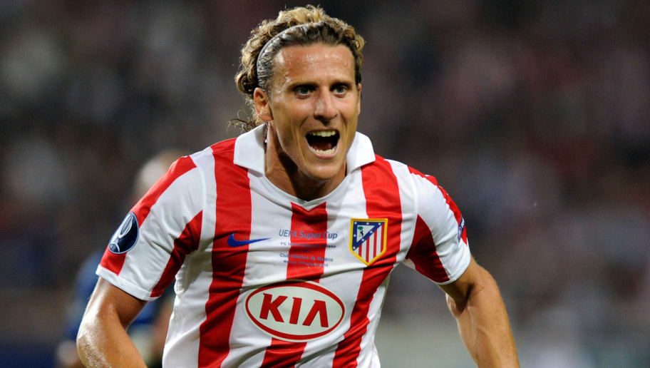 MONACO - AUGUST 27:  Diego Forlan of Atletico Madrid competes for the ball during the UEFA Super Cup between Inter and Atletico Madrid at Louis II Stadium on August 27, 2010 in Monaco, Monaco.  (Photo by Claudio Villa/Getty Images)