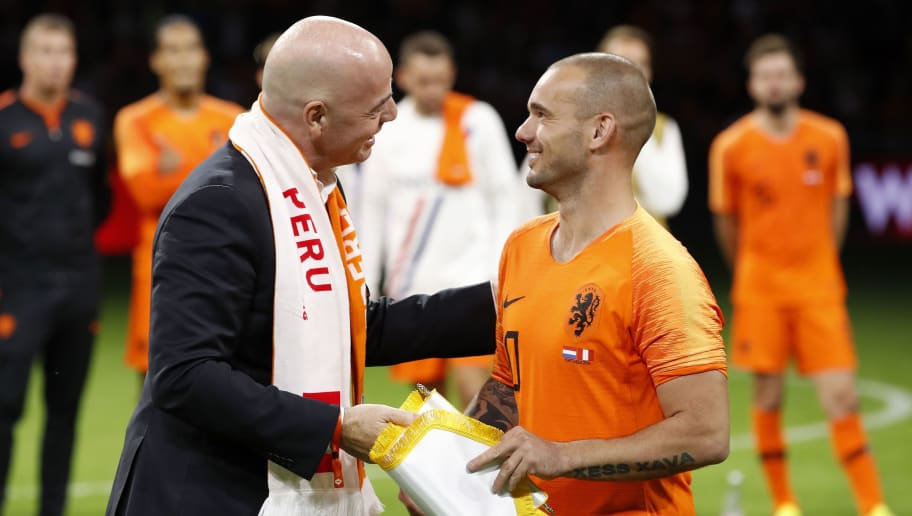 (L-R) FIFA president Gianni Infantino, Wesley Sneijder of Holland during the International friendly match match between The Netherlands and Peru at the Johan Cruijff Arena on September 06, 2018 in Amsterdam, The Netherlands(Photo by VI Images via Getty Images)
