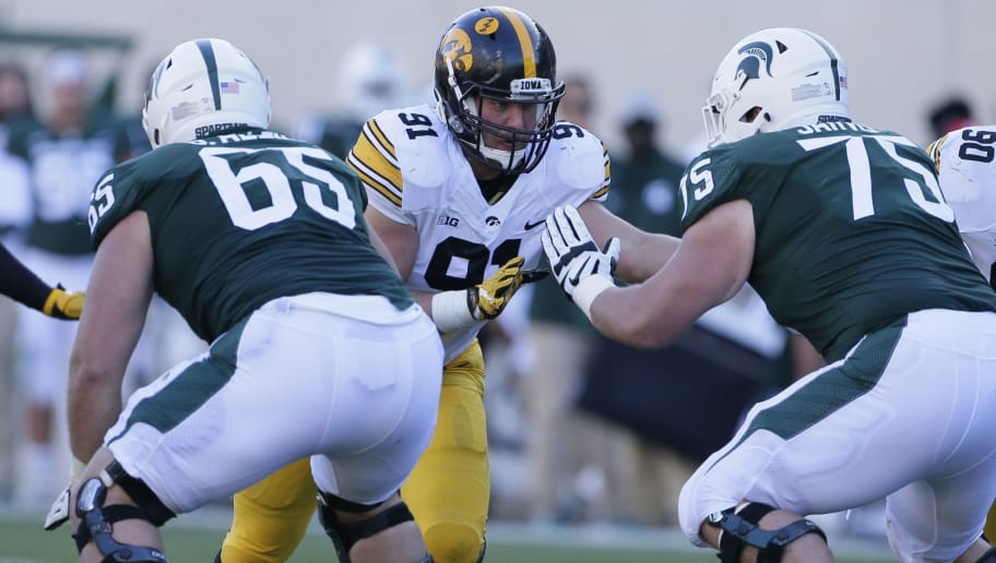 EAST LANSING, MI - SEPTEMBER 30:  Defensive lineman Brady Reiff #91 of the Iowa Hawkeyes goes up against offensive lineman Brian Allen #65 of the Michigan State Spartans and guard Kevin Jarvis #75 of the Michigan State Spartans during the first half at Spartan Stadium on September 30, 2017 in East Lansing, Michigan. (Photo by Duane Burleson/Getty Images)