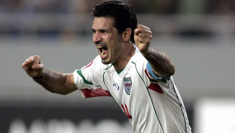 Iran's captain Ali Daei celebrates after