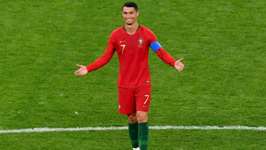 SARANSK, RUSSIA - JUNE 25:  Cristiano Ronaldo of Portugal reacts after receiving a yellowcard during the 2018 FIFA World Cup Russia group B match between Iran and Portugal at Mordovia Arena on June 25, 2018 in Saransk, Russia.  (Photo by Hector Vivas/Getty Images)