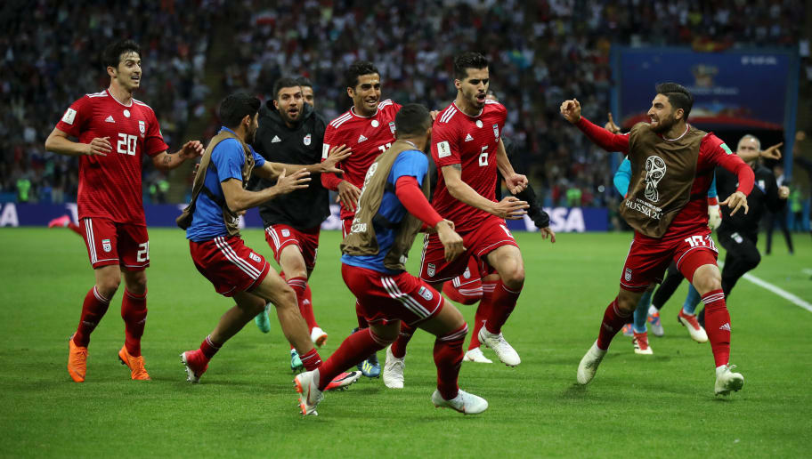 KAZAN, RUSSIA - JUNE 20:  Saeid Ezatolahi of Iran celebrates after scoring his team's first goal, which is then ruled offside and disallowed during the 2018 FIFA World Cup Russia group B match between Iran and Spain at Kazan Arena on June 20, 2018 in Kazan, Russia.  (Photo by Julian Finney/Getty Images)