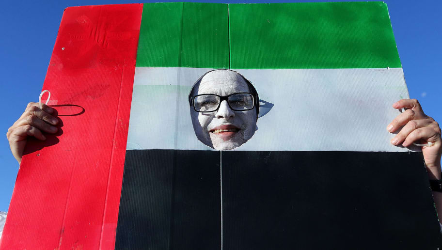 NEWCASTLE, AUSTRALIA - JANUARY 30:  A supporter holds a United Arab Emirates flag during the Third Place 2015 Asian Cup match between Iraq and the United Arab Emirates at Hunter Stadium on January 30, 2015 in Newcastle, Australia.  (Photo by Ashley Feder/Getty Images)