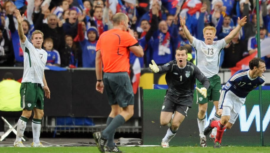 Irish national football team midfielder Liam Lawrence  (L), goalkeeper Given (3dR) and defender Paul Mc Shane shout to Swedish referee Martin Hansson (C) as French defender Sebastien Squillaci (R) jubilates after the goal by French defender William Gallas during the World Cup 2010 qualifying football match France vs. Republic of Ireland on November 18, 2009 at the Stade de France in Saint-Denis, northern Paris. Superstar Thierry Henry was at the centre of a sensational cheating storm as France reached the World Cup finals along with Portugal, Greece and Slovenia. France, the 1998 champions and 2006 runners-up, drew 1-1 with Ireland at the Stade de France in the second leg of their play-off for a 2-1 aggregate win. But the extra-time triumph came in controversial circumstances when French skipper Henry appeared to control the ball with his hand before his angled pass allowed Gallas to head in the crucial 103rd-minute goal. AFP PHOTO / LIONEL BONAVENTURE (Photo credit should read LIONEL BONAVENTURE/AFP/Getty Images)