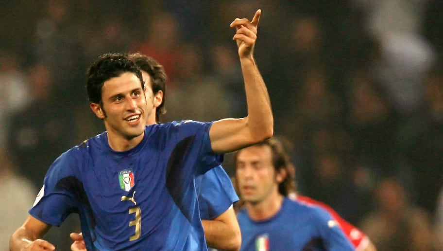 Italian defender Fabio Grosso (L) celebrates after scoring a goal against Georgia during the Euro 2008 group B qualifying football match Italy vs.Georgia at Luigi Ferraris stadium in Genoa 13 October 2007. AFP PHOTO / ALBERTO PIZZOLI (Photo credit should read ALBERTO PIZZOLI/AFP/Getty Images)