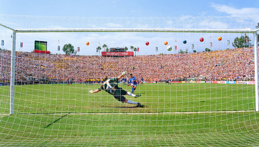 LOS ANGELES, UNITED STATES:  Italian forward Roberto Baggio watches his penalty kick go over the crossbar as Brazilian goalkeeper Claudio Taffarel dives the wrong way during the penalty shoot-out of the Soccer World Cup final, 17 July 1994 at the Rose Bowl in Los Angeles. Baggio's miss gave Brazil a 3-2 victory (0-0 after extra time) and its fourth World Cup title (1958, 1962, 1970, 1994).    AFP PHOTO/CHRIS WILKINS (Photo credit should read CHRIS WILKINS/AFP/Getty Images)