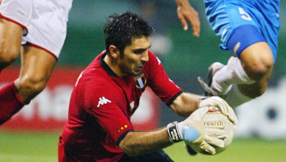 Italy's goalkeeper Gianluigi  Buffon makes a save during second half action of match 43 group G of the 2002 FIFA World Cup Korea Japan 13 June, 2002 in Oita, Japan. AFP PHOTO GERARD JULIEN (Photo credit should read GERARD JULIEN/AFP/Getty Images)
