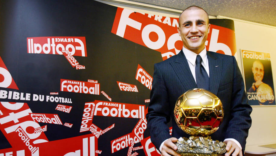 Paris, FRANCE:  Italy's World Cup-winning captain Fabio Cannavaro poses next to his trophy after being awarded the 2006 'Ballon d'Or' (Golden Ball), for best football player of the year, 27 November 2006 in Paris. AFP PHOTO FRANCK FIFE  (Photo credit should read FRANCK FIFE/AFP/Getty Images)
