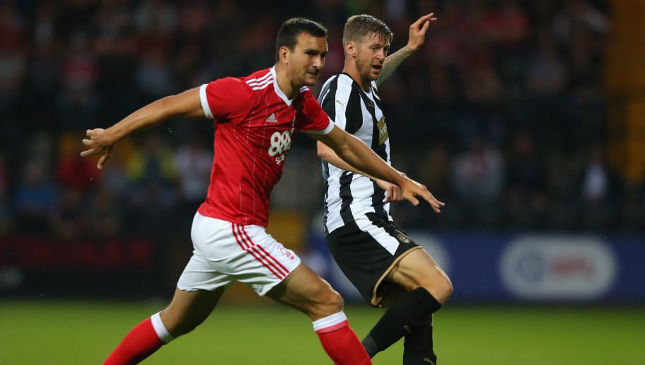 NOTTINGHAM, ENGLAND - JULY 19:  Jon Stead of Notts County beats Jack Hobbs of Nottingham Forest during a pre-season friendly match between Notts County and Nottingham Forest at Meadow Lane on July 19, 2017 in Nottingham, England.  (Photo by Alex Livesey/Getty Images)