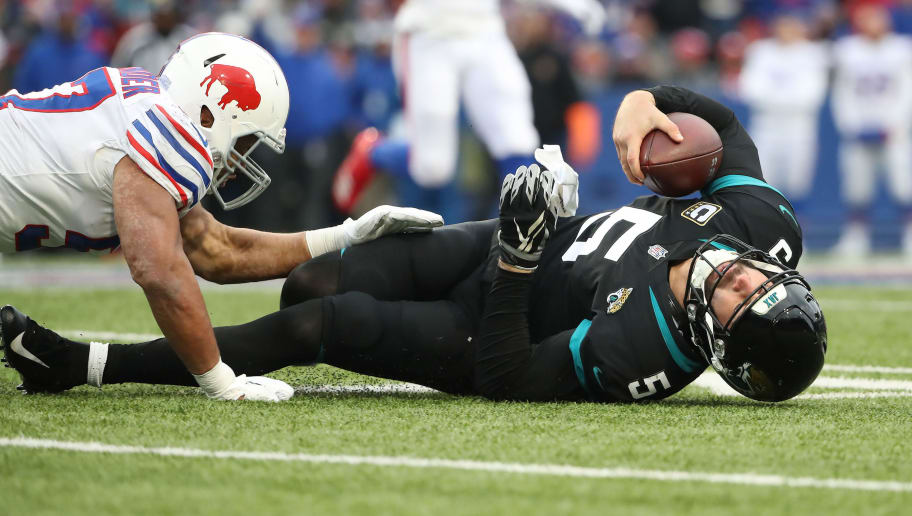 BUFFALO, NY - NOVEMBER 25: Blake Bortles #5 of the Jacksonville Jaguars is tackled by Lorenzo Alexander #57 of the Buffalo Bills as he runs with the ball in the third quarter during NFL game action at New Era Field on November 25, 2018 in Buffalo, New York. (Photo by Tom Szczerbowski/Getty Images)
