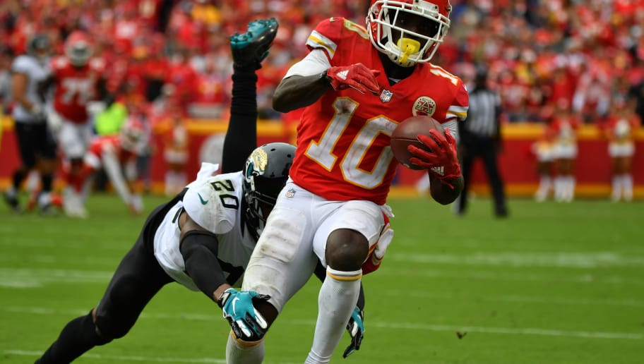 KANSAS CITY, MO - OCTOBER 7: Tyreek Hill #10 of the Kansas City Chiefs brings in a pass in front of Jalen Ramsey #20 of the Jacksonville Jaguars during the third quarter of the game at Arrowhead Stadium on October 7, 2018 in Kansas City, Missouri. (Photo by Peter Aiken/Getty Images)