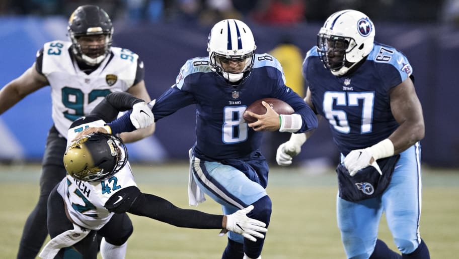 NASHVILLE, TN - DECEMBER 31:  Marcus Mariota #8 of the Tennessee Titans runs the ball and stiff arms Barry Church #42 of the Jacksonville Jaguars at Nissan Stadium on December 31, 2017 in Nashville, Tennessee.  The Titans defeated the Jaguars 15-10.  (Photo by Wesley Hitt/Getty Images)