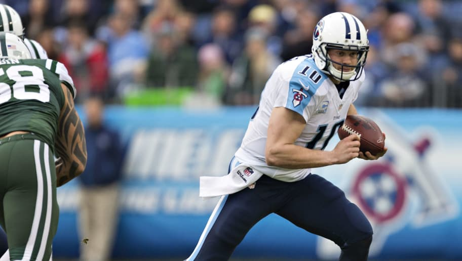 NASHVILLE, TN - DECEMBER 14:  Jake Locker #10 of the Tennessee Titans rolls out to avoid the rush during the first quarter of a game against the New York Jets at LP Field on December 14, 2014 in Nashville, Tennessee.  (Photo by Wesley Hitt/Getty Images)