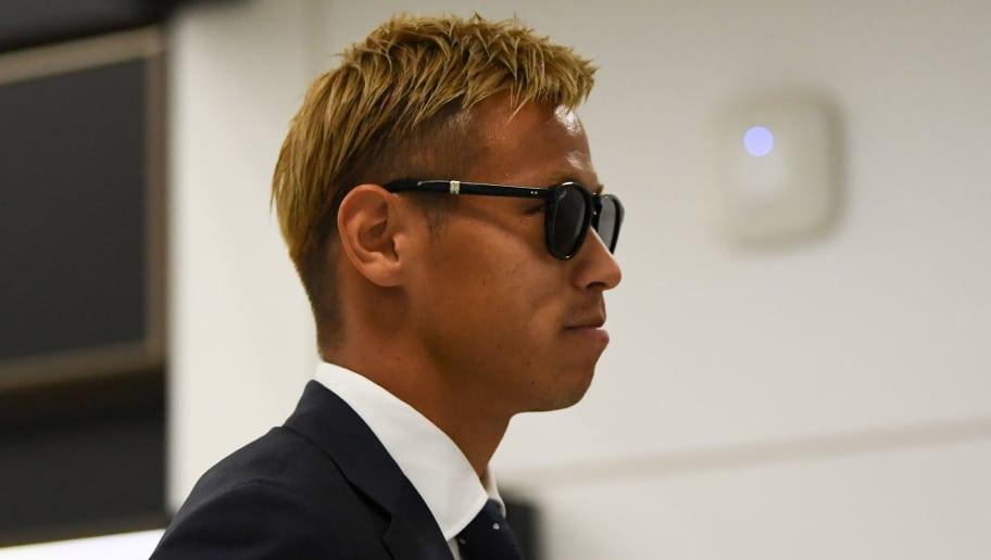 NARITA, JAPAN - JULY 05: Keisuke Honda is seen on arrival at Narita International Airport on July 5, 2018 in Narita, Narita, Japan.  (Photo by Takashi Aoyama/Getty Images)