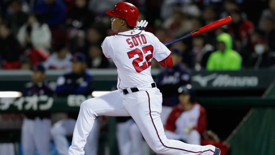 HIROSHIMA, JAPAN - NOVEMBER 13:  Outfielder Juan Soto #22 of the Washington Nationals hits a RBI double to make it 2-0 in the bottom of 7th inning during the game four between Japan and MLB All Stars at Mazda Zoom Zoom Stadium Hiroshima on November 13, 2018 in Hiroshima, Japan.  (Photo by Kiyoshi Ota/Getty Images)