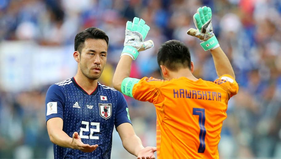 VOLGOGRAD, RUSSIA - JUNE 28:  Maya Yoshida of Japan and Eiji Kawashima of Japan celebrate followingthe 2018 FIFA World Cup Russia group H match between Japan and Poland at Volgograd Arena on June 28, 2018 in Volgograd, Russia.  (Photo by Alex Livesey/Getty Images)