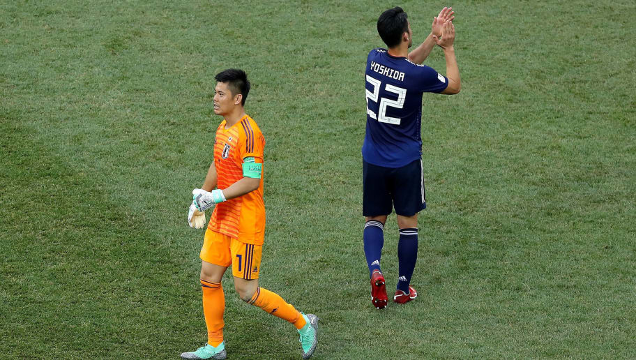 VOLGOGRAD, RUSSIA - JUNE 28:  Maya Yoshida of Japan and Eiji Kawashima of Japan celebrate followingthe 2018 FIFA World Cup Russia group H match between Japan and Poland at Volgograd Arena on June 28, 2018 in Volgograd, Russia.  (Photo by Richard Heathcote/Getty Images)