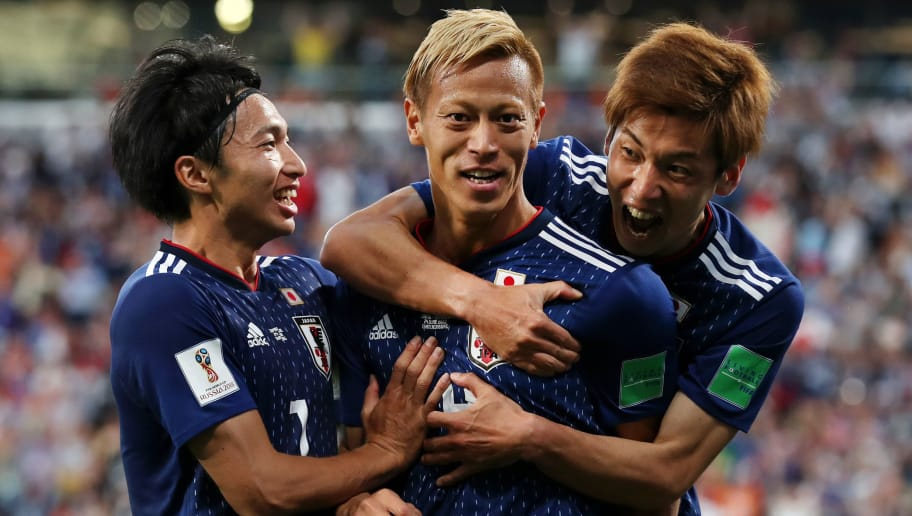 YEKATERINBURG, RUSSIA - JUNE 24:  Keisuke Honda of Japan celebrates with teammate Yuya Osako after scoring his team's second goal during the 2018 FIFA World Cup Russia group H match between Japan and Senegal at Ekaterinburg Arena on June 24, 2018 in Yekaterinburg, Russia.  (Photo by Clive Rose/Getty Images)