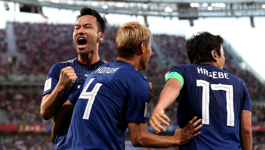 YEKATERINBURG, RUSSIA - JUNE 24:  Keisuke Honda of Japan celebrates with teammate Maya Yoshida after scoring his team's second goal during the 2018 FIFA World Cup Russia group H match between Japan and Senegal at Ekaterinburg Arena on June 24, 2018 in Yekaterinburg, Russia.  (Photo by Clive Rose/Getty Images)
