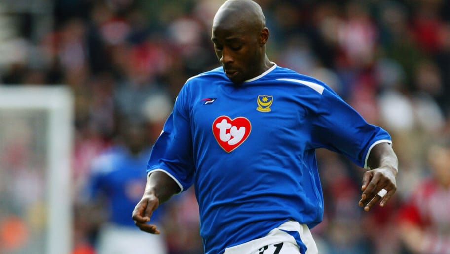 SOUTHAMPTON - DECEMBER 21:  Jason Roberts of Portsmouth running with the ball during the FA Barclaycard Premiership match between Southampton and Portsmouth on December 21, 2003 at St Mary's Stadium in Southampton, England. Southampton won the match 3-0. (Photo by Mike Hewitt/Getty Images)