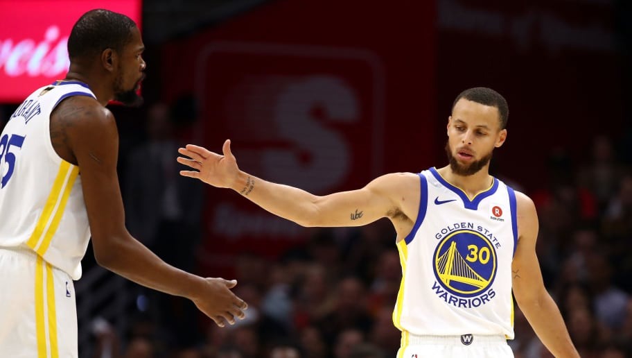 CLEVELAND, OH - JUNE 08: Stephen Curry #30 and Kevin Durant #35 of the Golden State Warriors react after a play in the first quarter against the Cleveland Cavaliers during Game Four of the 2018 NBA Finals at Quicken Loans Arena on June 8, 2018 in Cleveland, Ohio. NOTE TO USER: User expressly acknowledges and agrees that, by downloading and or using this photograph, User is consenting to the terms and conditions of the Getty Images License Agreement.  (Photo by Gregory Shamus/Getty Images)