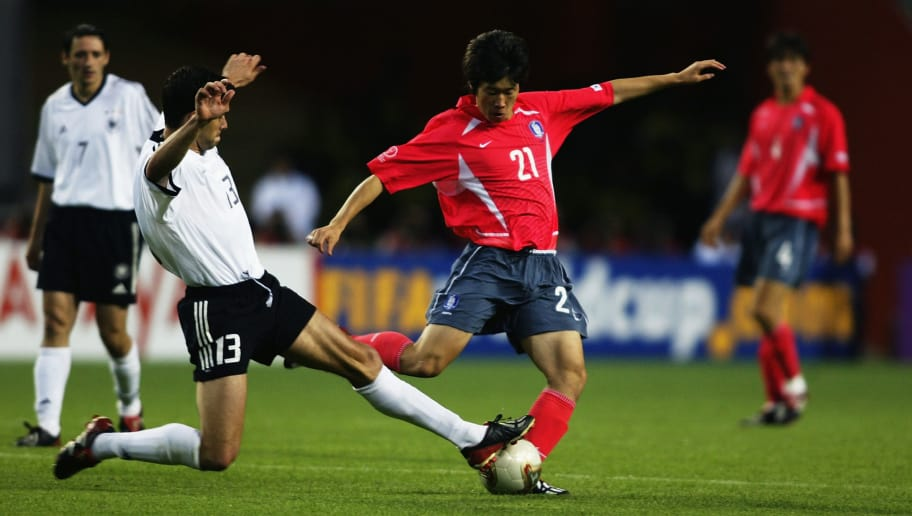 SEOUL - JUNE 25:  Ji Sung Park of South Korea is tackled by Michael Ballack of Germany during the FIFA World Cup Finals 2002 Semi-Final match played at the Seoul World Cup Stadium, in Seoul, South Korea on June 25, 2002. Germany won the match 1-0. DIGITAL IMAGE. (Photo by Gary M. Prior/Getty Images)