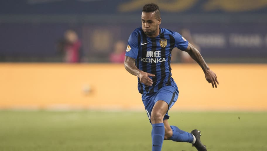 NANJING, CHINA - APRIL 01:  Alex Teixeira Santos #10 of Jiangsu Suning FC in action during the 2018 Chinese Super League match between Jiangsu Suning and Tianjin Teda at Nanjing Olympic Sports Center on April 1, 2018 in Nanjing, China.  (Photo by XIN LI/Getty Images)