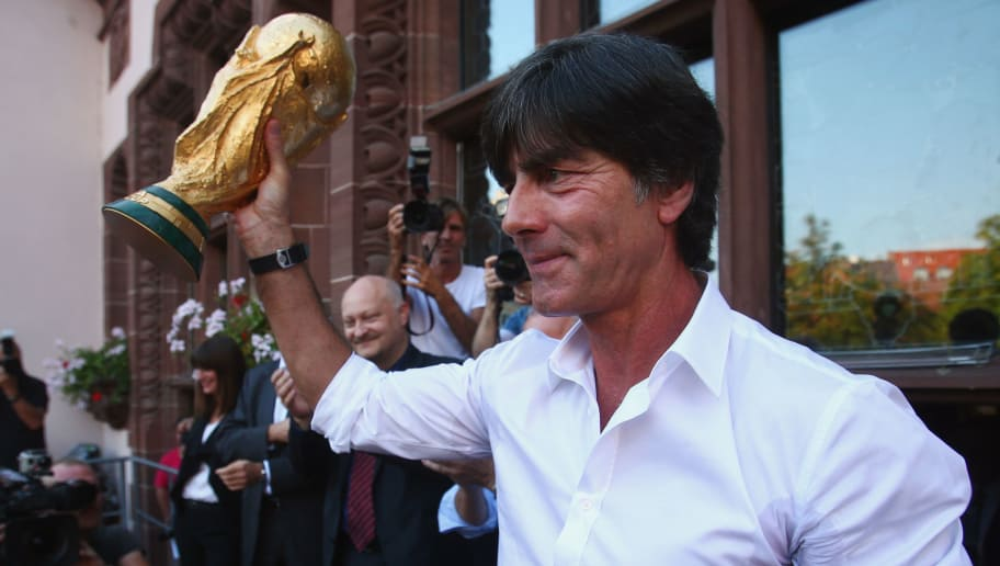 FREIBURG IM BREISGAU, GERMANY - SEPTEMBER 09:  Germany coach Joachim Loew presents the FIFA World Cup trophy during a reception in his honour on September 9, 2014 in Freiburg im Breisgau, Germany.  (Photo by Alex Grimm/Bongarts/Getty Images)