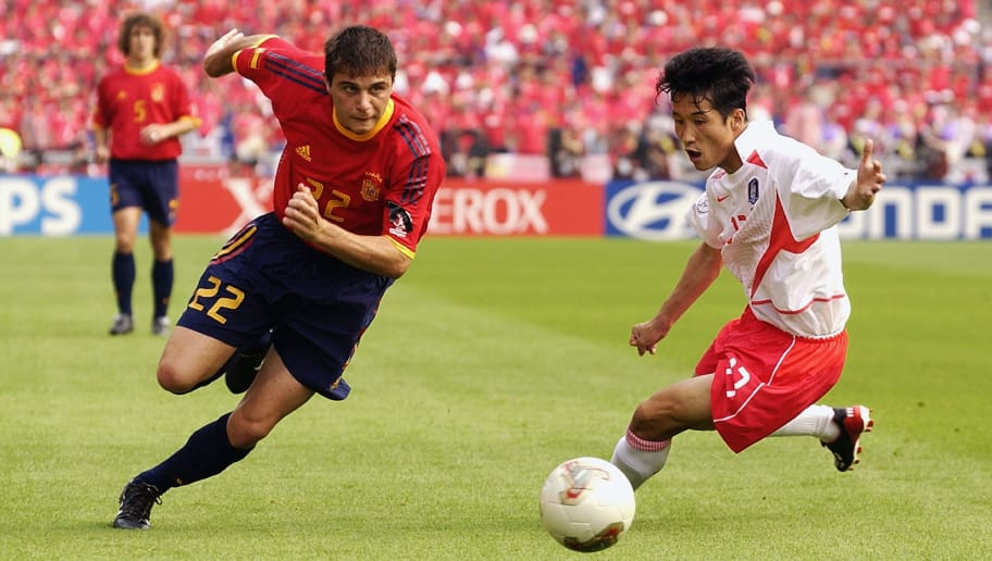 GWANGJU - JUNE 22:  Joaquin of Spain takes the ball past Eul Yong Lee of South Korea during the FIFA World Cup Finals 2002 Quarter Finals match played at the Gwangju World Cup Stadium, in Gwangju, South Korea on June 22, 2002. The match ended in a 0-0 draw after extra-time, with South Korea winning 5-3 on penalties. DIGITAL IMAGE. (Photo by Shaun Botterill/Getty Images)