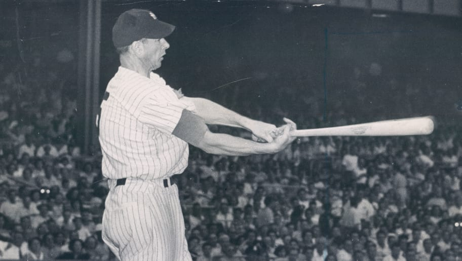 THE BRONX, NY - 1949: New York Yankee Joe DiMaggio hits the ball at Yankee Stadium on June 28, 1949. (Sports Studio Photos/Getty Images)