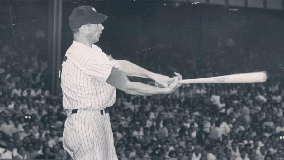 THE BRONX, NY - 1949: New York Yankee Joe DiMaggio hits the ball at Yankee Stadium on June 28, 1949. (Sports Studio Photos/Getty Images)