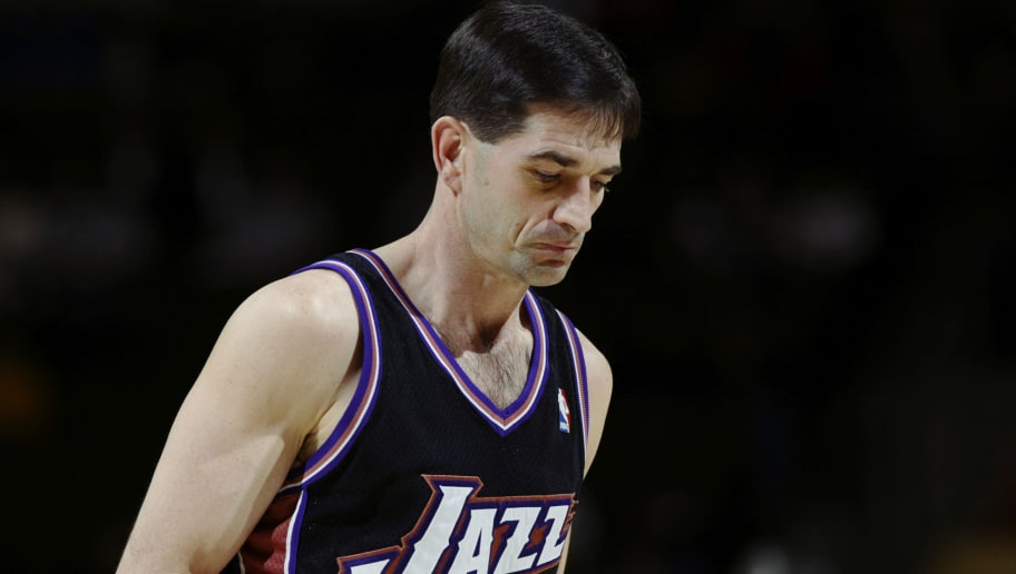 DENVER - JANUARY 15:  John Stockton #12 of the Utah Jazz looks on against the Denver Nuggets during the game at Pepsi Center on January 15 2003 in Denver, Colorado.  The Jazz won 92-81.  NOTE TO USER:  User expressly acknowledges and agrees that, by downloading and/or using this Photograph, User is consenting to the terms and conditions of the Getty Images License Agreement. (Photo By: Brian Bahr/Getty Images)