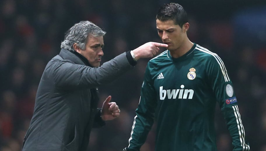 MANCHESTER, ENGLAND - MARCH 05:  Real Madrid Manager Jose Mourinho gives orders to Cristiano Ronaldo during the UEFA Champions League Round of 16 Second leg match between Manchester United and Real Madrid at Old Trafford on March 5, 2013 in Manchester, United Kingdom.  (Photo by Jasper Juinen/Getty Images)